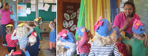 Schoolroom Two children having fun during Caterpillar music